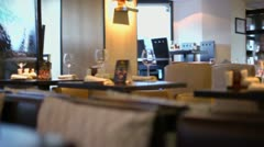 Several clients sit behind water walls in resturant - stock footage