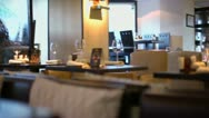 Stock Video Footage of Several clients sit behind water walls in resturant