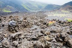 lava rocks close up on volcano slope of etna - stock photo