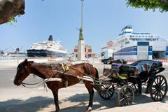 Horse-drawn taxi in seaport in palermo Stock Photos