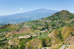 etna and agricultural gardens on flank of hills in sicily - stock photo
