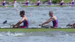 Mens teams row in kayak during competition at Moscow Regatta Stock Footage