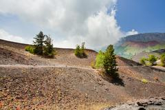 Mountain path in clinker ground on volcano etna Stock Photos