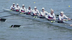 Rowing team sit in kayak during competition at Regatta Stock Footage