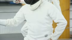 Fencer moves with rapier during training in gym, closeup view Stock Footage