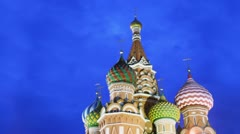 Colourful cupolas of Saint Basils Cathedral and cloudy sky Stock Footage