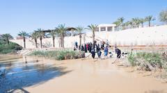baptized people in jesus christ baptism site in jordan river - stock photo