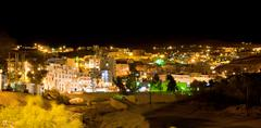 night view of town wadi musa, the closest town to the petra, jordan - stock photo