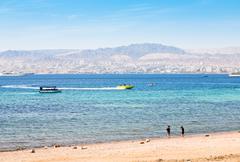 municipal aqaba beach and view on eilat town - stock photo