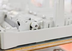 Plastic gears of disassembled printer Stock Photos