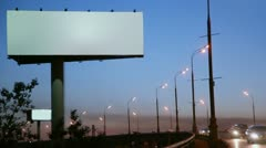 Empty advertising billboard on sidelines of road with traffic Stock Footage