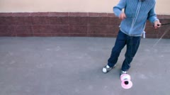 Boy plays with diabolo toy near wall, closeup view in motion Stock Footage