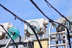 glass isolators of electric line - stock photo