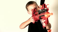 Cute kid shooting a toy crossbow Stock Footage