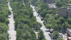 City streets which are buried in verdure on which there go cars Stock Footage