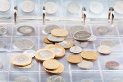 Numismatics album with different coins Stock Photos