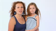 Mother embraces daughter and they speak while in them blows wind Stock Footage