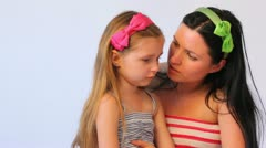 Stock Video Footage of mother speaks with sad daughter, consoles it and embraces