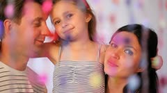 Daughter embraces parents, irons them on hair, talks and smiles Stock Footage