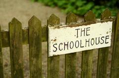 Schoolhouse gate - stock photo