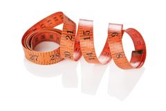 measuring tape of the tailor isolated - stock photo