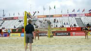 Stock Video Footage of Workers level sand on sports ground on beach volleyball