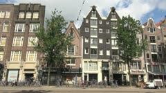 Netherlands Amsterdam gabled buildings above bikes on street 1 - stock footage
