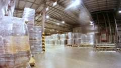 Loader transports containers with kvass in warehouse of plant Stock Footage