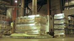 Machine wrap up by overwrap of container with kvass bottles Stock Footage