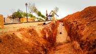 Loader Excavator working in a construction site, tilt shift effect Stock Footage