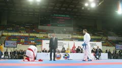 Two karatekas participate in duel on championship on karate Stock Footage