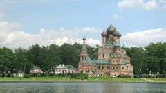 Temple of Trinity stands near river against sky in Ostankino Stock Footage