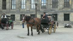 Netherlands Amsterdam horse drawn carriage dam square Stock Footage