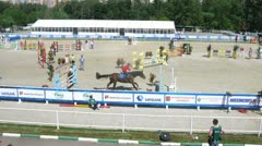 Athletes participate in horse competitions on pentathlon Stock Footage