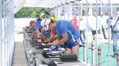 Athletes clothe numbers of participants of competitions Stock Footage