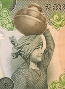 Girl with Vessel on Head on 500 Riels Banknote from Cambodia - stock photo