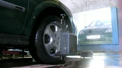 Mechanic tests wheel alignment camber of car Stock Footage