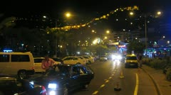 Cars quickly go on streets of Alanya at night Stock Footage