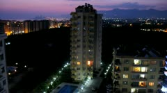 Multi-storey buildings stands against night city landscape Stock Footage