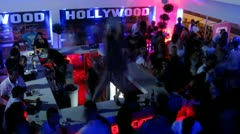 Girls dance on table in bar on open area of night club Hollywood Stock Footage