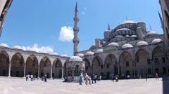 People walk in courtyard of Sultan Ahmet Mosque Stock Footage
