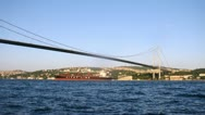 Ships float near Bosporus Bridge against city landscape Stock Footage