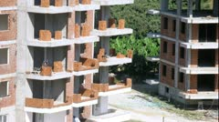 Workers erect balconies from brick in new building, time lapse Stock Footage