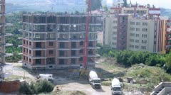 Workers erect ferro-concrete framework of new building. - stock footage