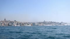 Passengers sit in walking ships which float in bay Golden horn Stock Footage