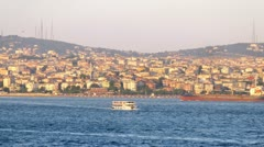 Maiden Tower stands against an Asian part of Istanbul and sky Stock Footage