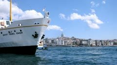 Ship leaves mooring against Galata Tower Stock Footage
