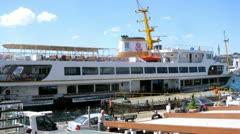 People walk near restaurant and Karakoy-Kadikoy ferry Stock Footage