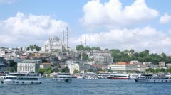 Walking ships float in front of Suleymaniye Mosque, time lapse Stock Footage