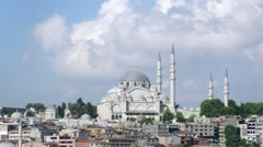 Suleymaniye Mosque stands against city landscape and blue sky Stock Footage